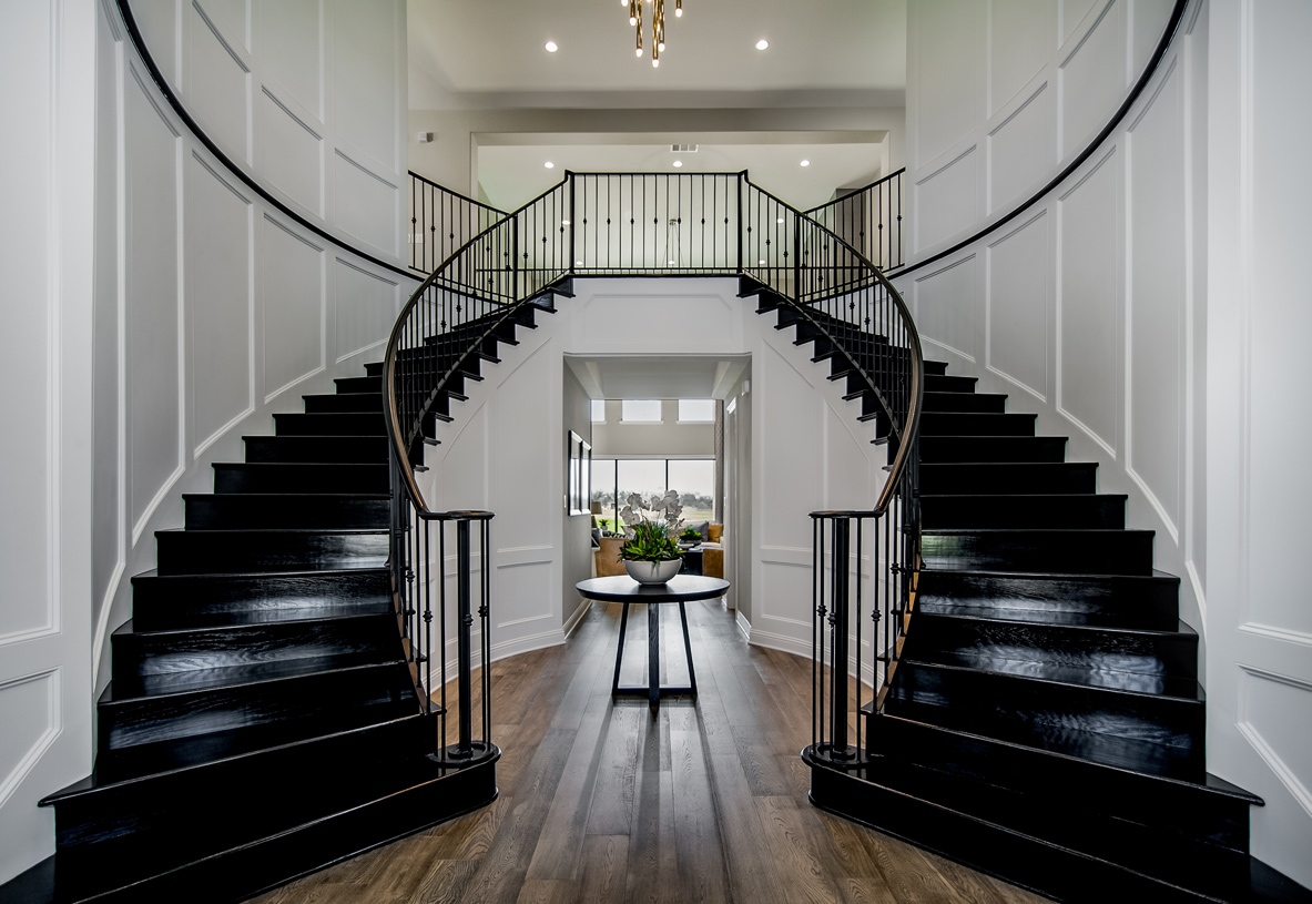 Inviting dual-curved staircase in the Monte Verde