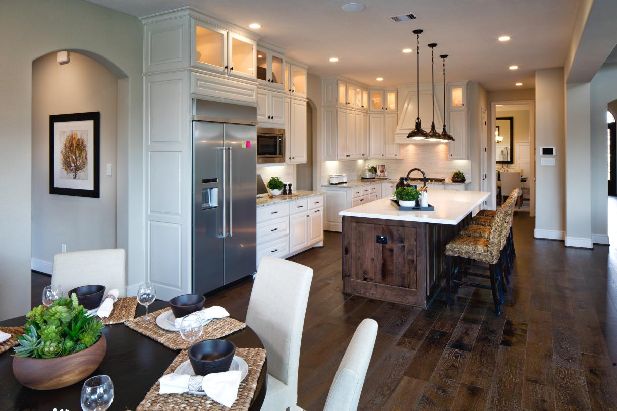 Gourmet kitchen with central island and casual dining area
