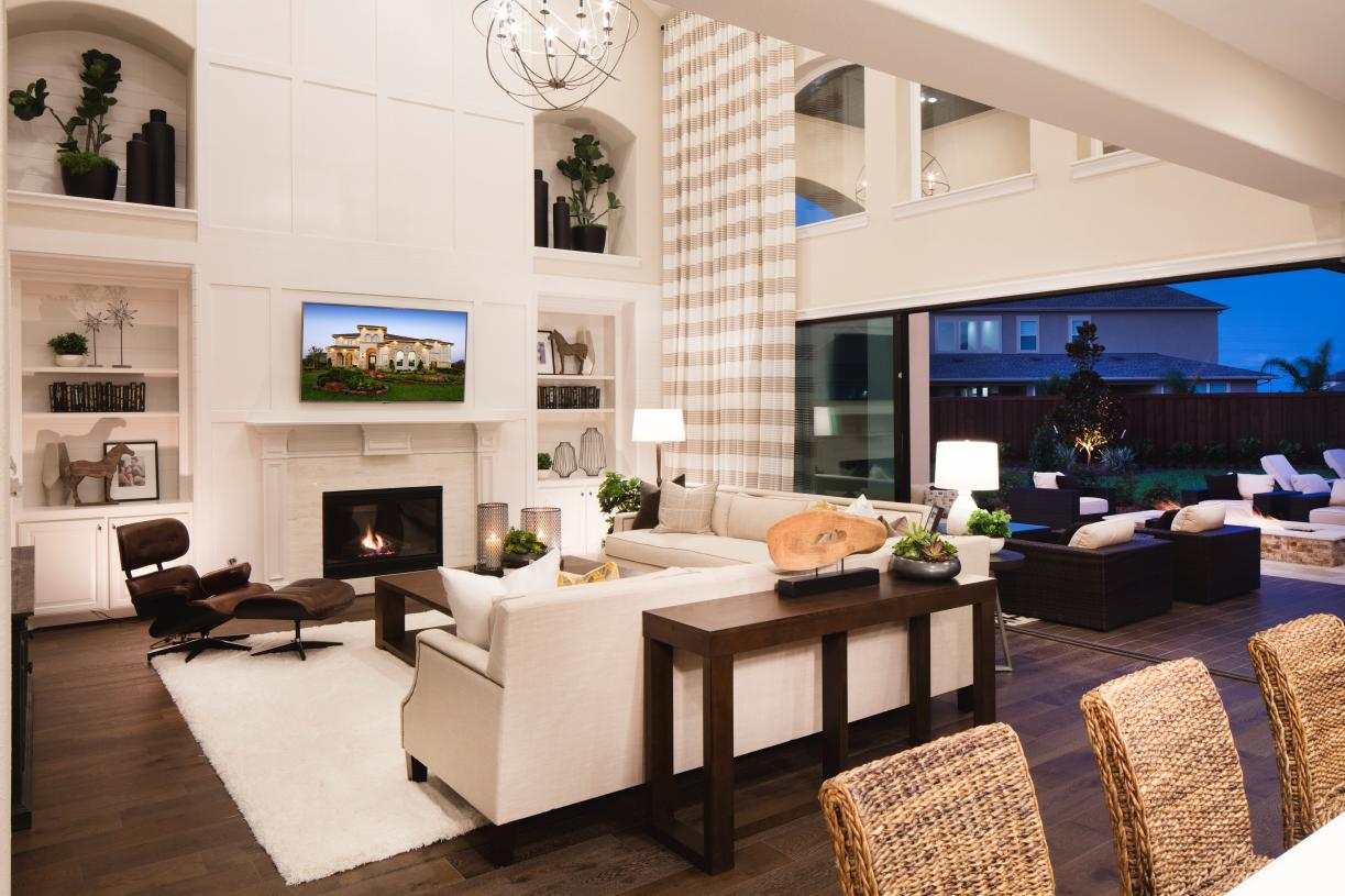 Expansive great room with central fireplace and optional sliding glass doors