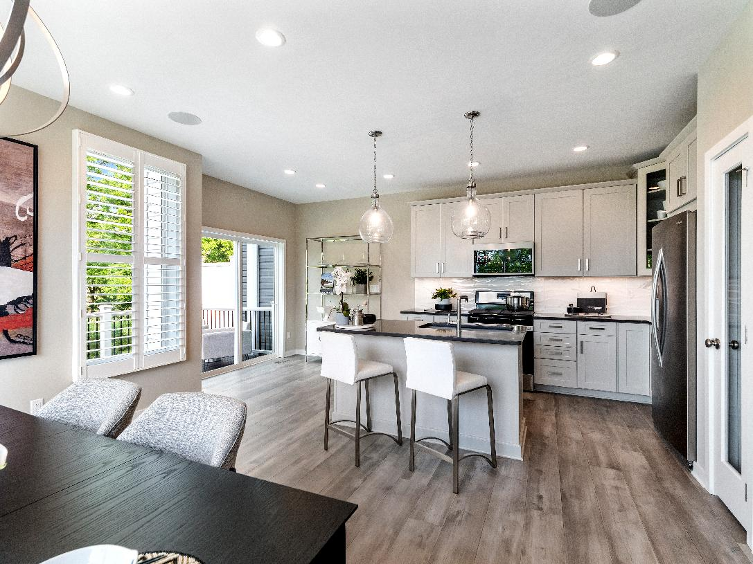 Well-appointed gourmet kitchens with stainless steel appliances