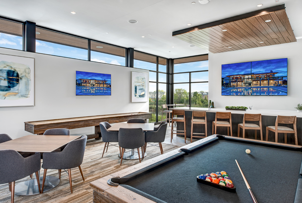 The perfect hangout with shuffleboard, pool table, and bar