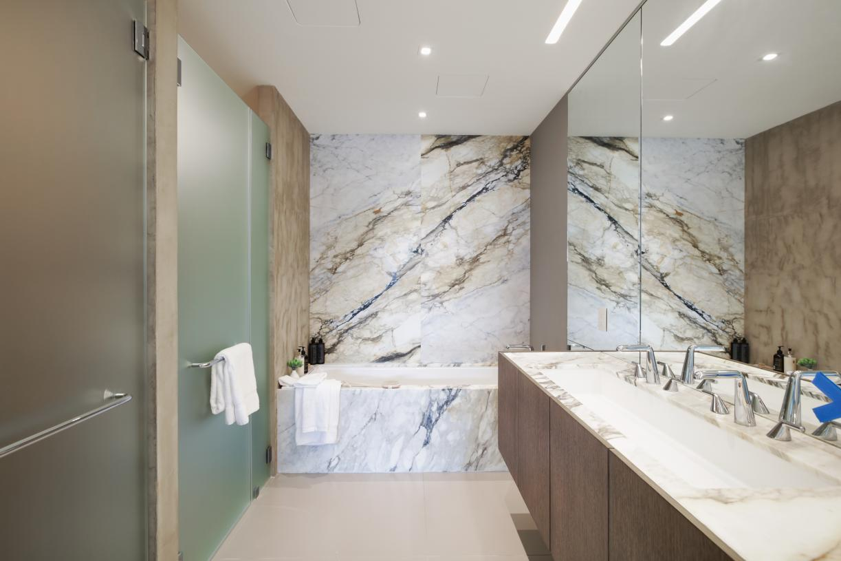 Primary baths with roman tub, clad in striking Calacatta Paonazzo marble