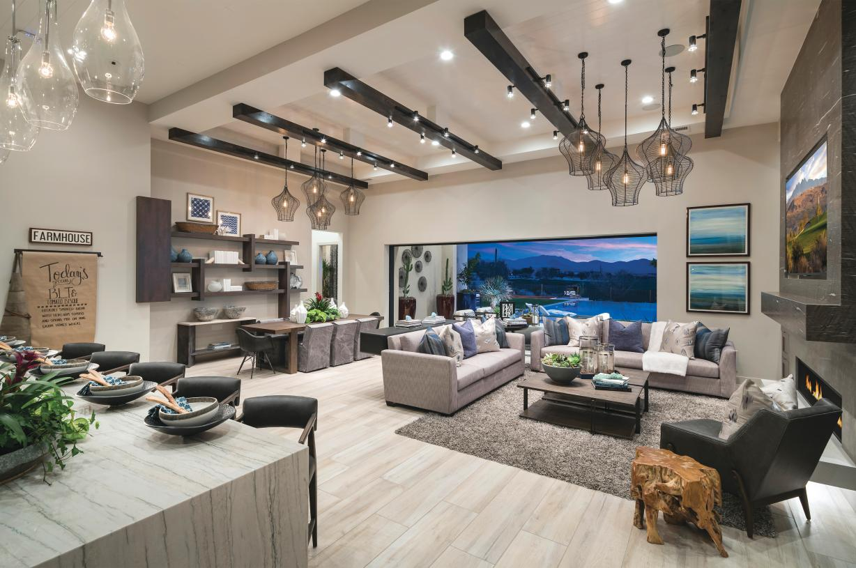 Open-concept home designs that open to large covered patios, ideal for entertaining