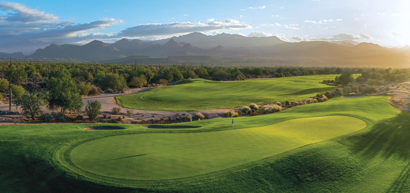 18-hole golf course with stunning mountain backdrop