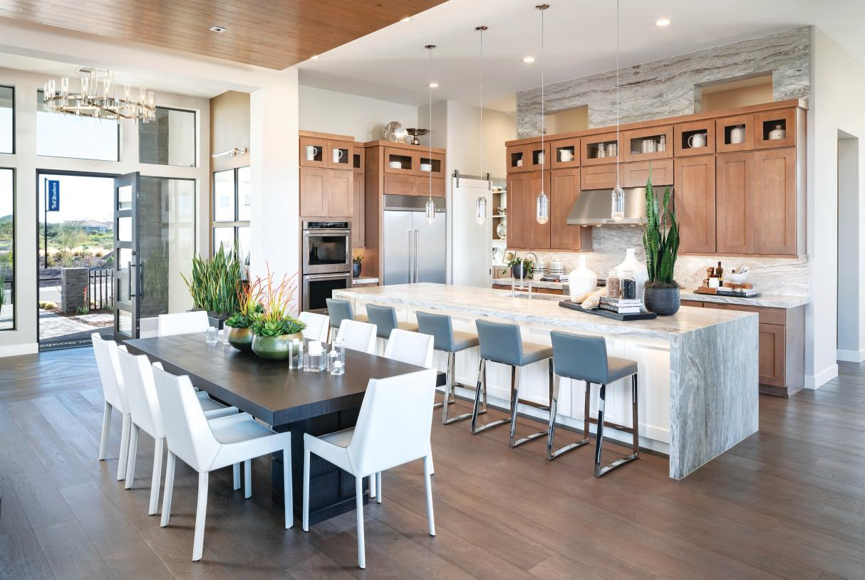 Well-appointed kitchens with large center islands, premium finishes and stainless steel appliances