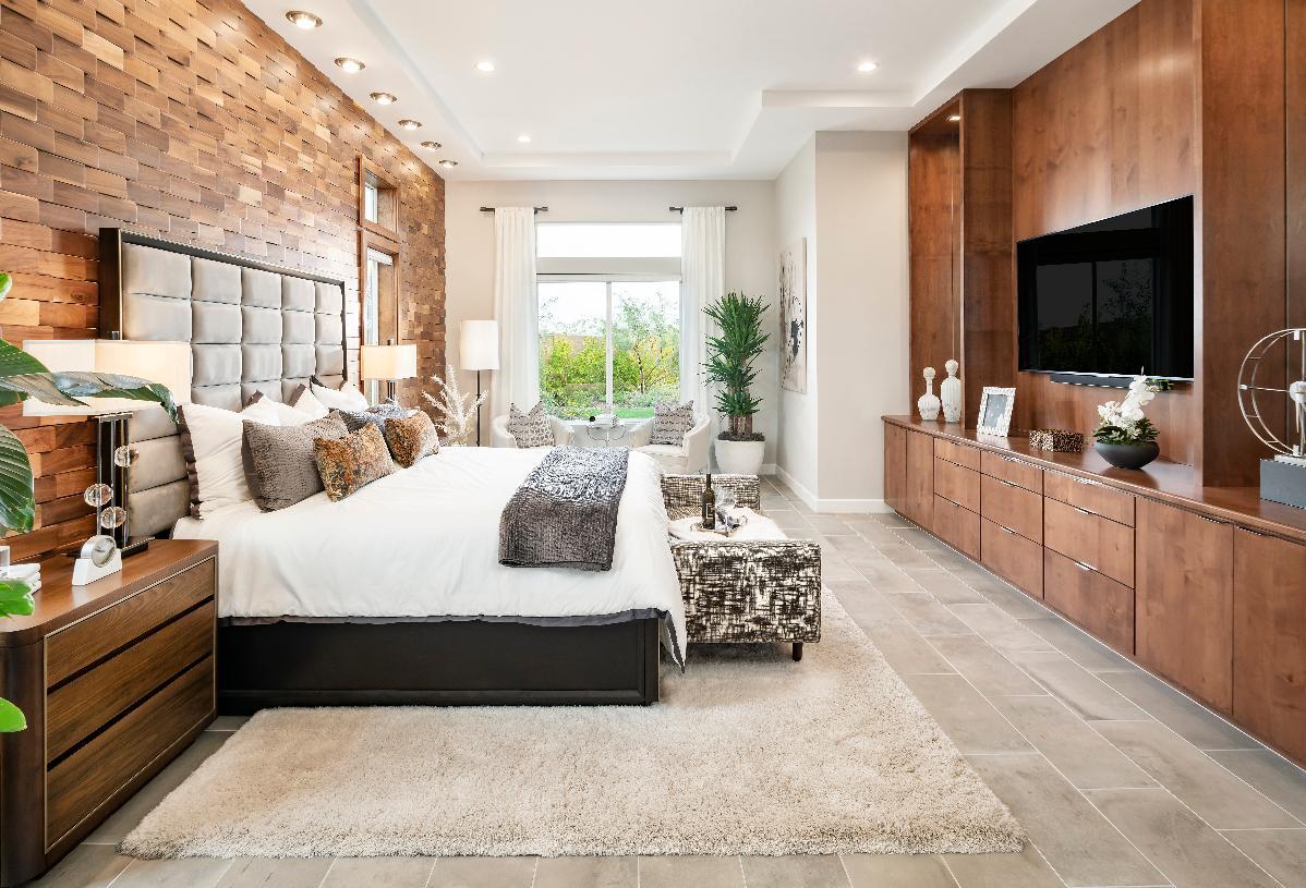 Impressive primary bedroom suite lit by beautiful windows