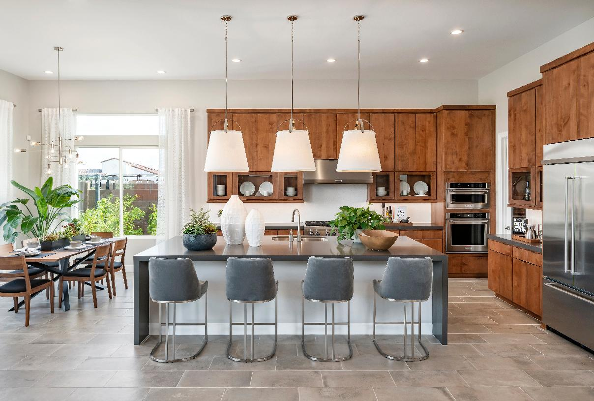 Gourmet kitchen features a large center island and breakfast bar