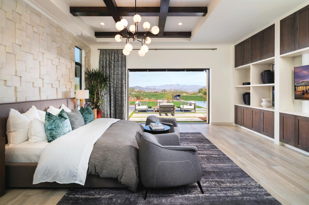 Grand primary suite with direct outdoor access and golf course views