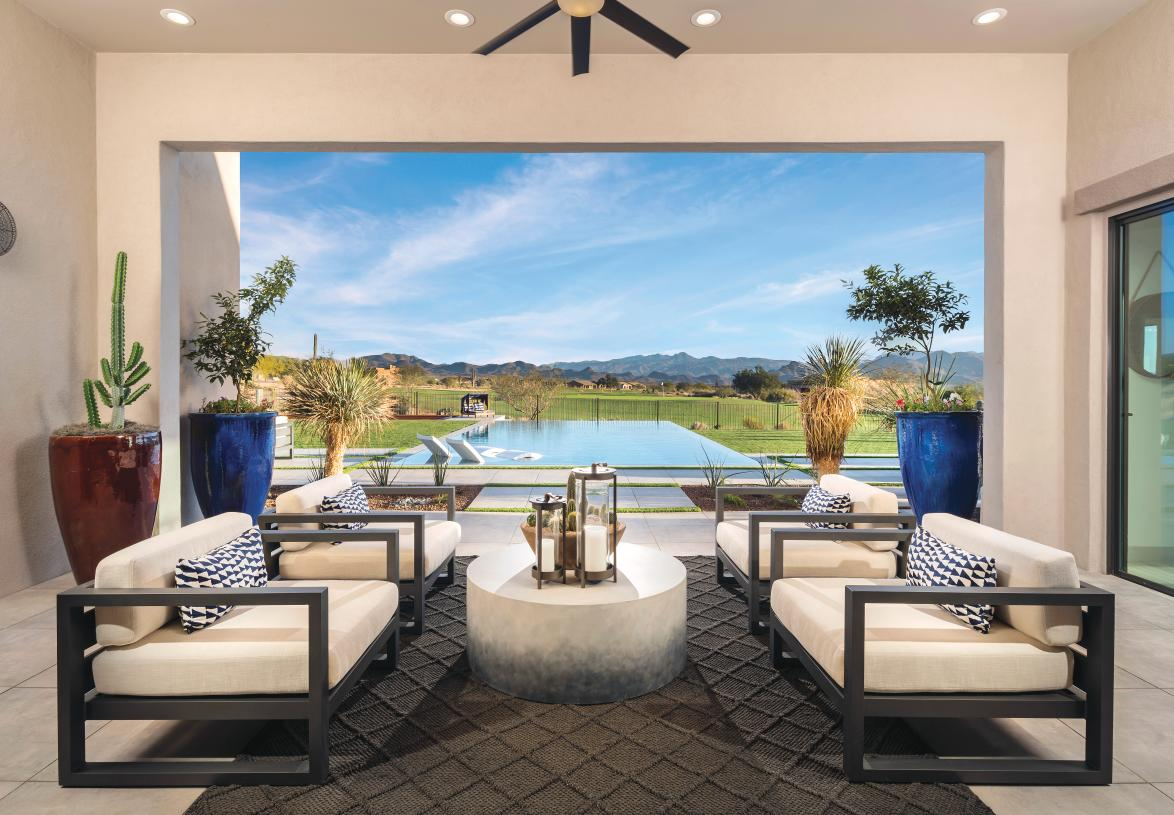Expansive covered patio overlooking a resort-style pool and golf course