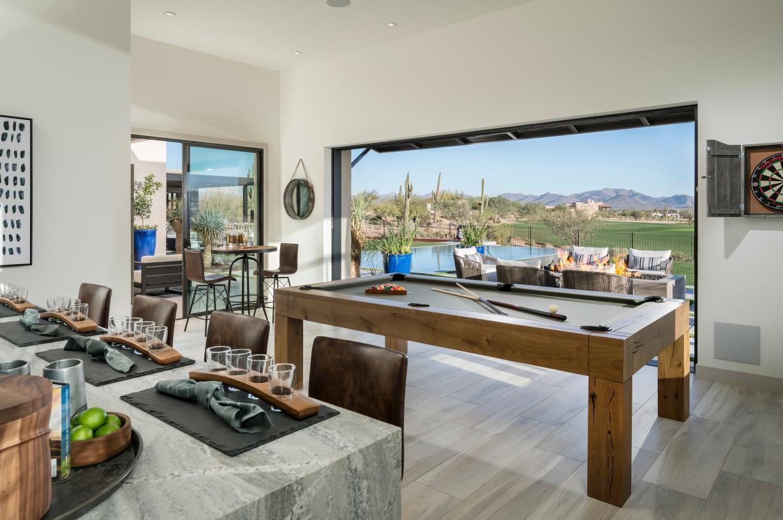 Versatile bonus room flows seamlessly to outdoor living space