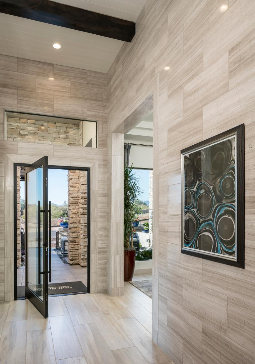 Welcoming foyer with elevated ceiling