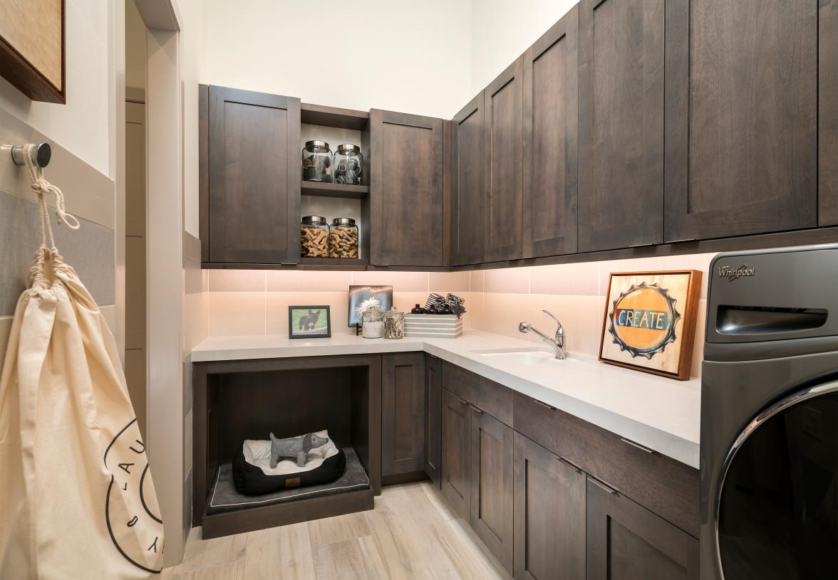 Sizeable laundry room with ample storage and sink