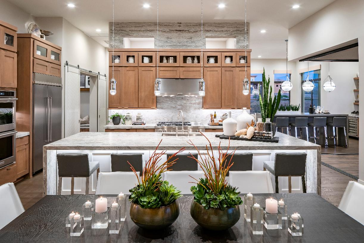 Kitchen enhanced by a large center island with breakfast bar and ample counter and cabinet space