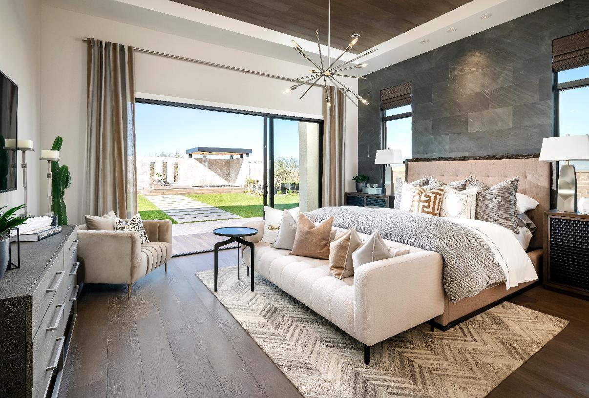 Spacious primary bedroom suite with multi-slide patio door