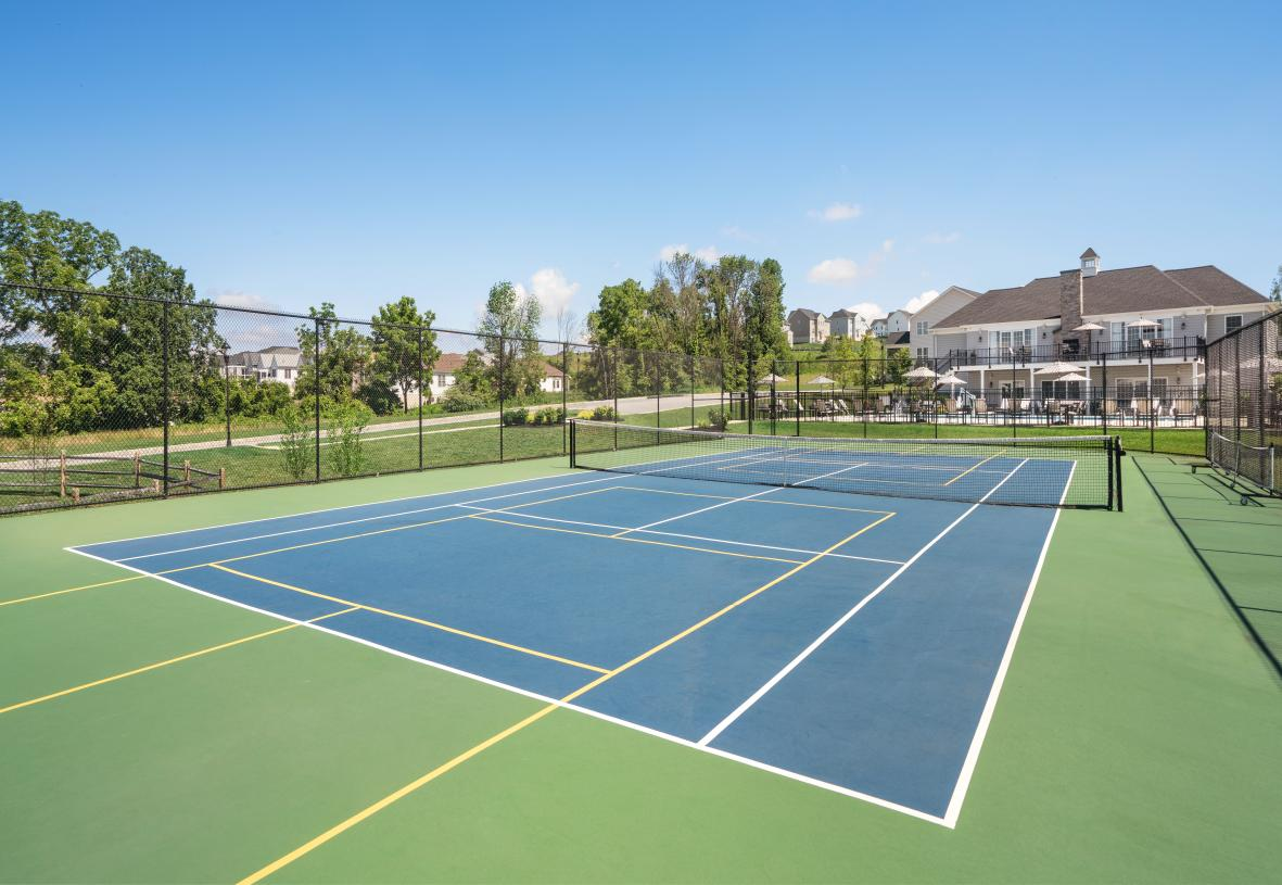 Play pickleball or tennis on the community courts
