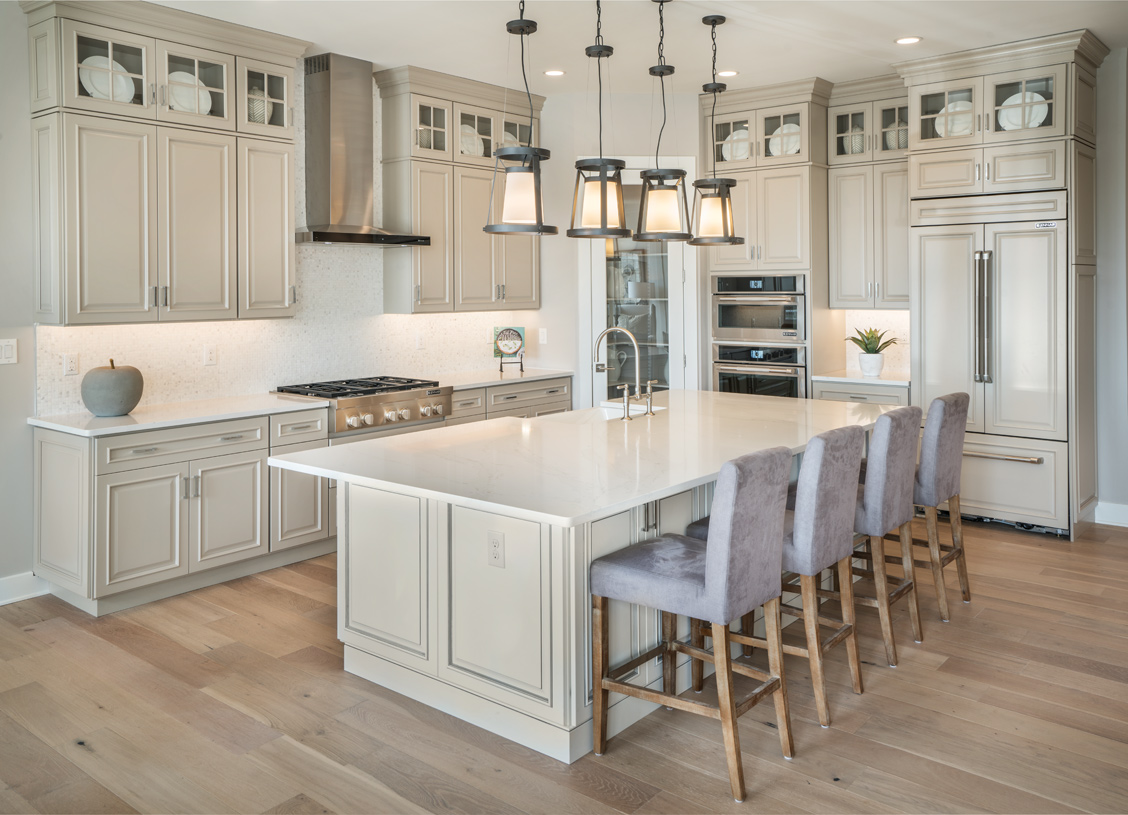 Spacious kitchens with granite countertops and stainless steel appliances