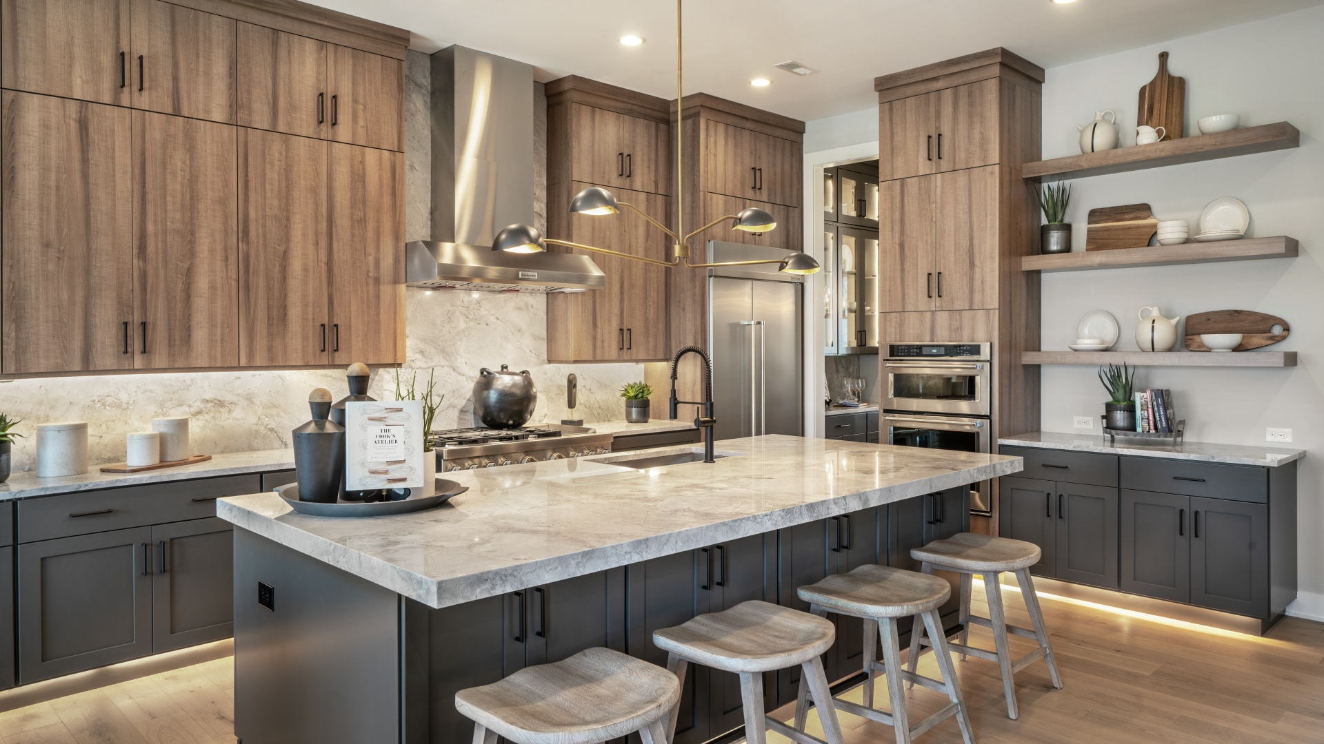 Gourmet kitchen includes large center island, ample counter and cabinet space, and pantry storage