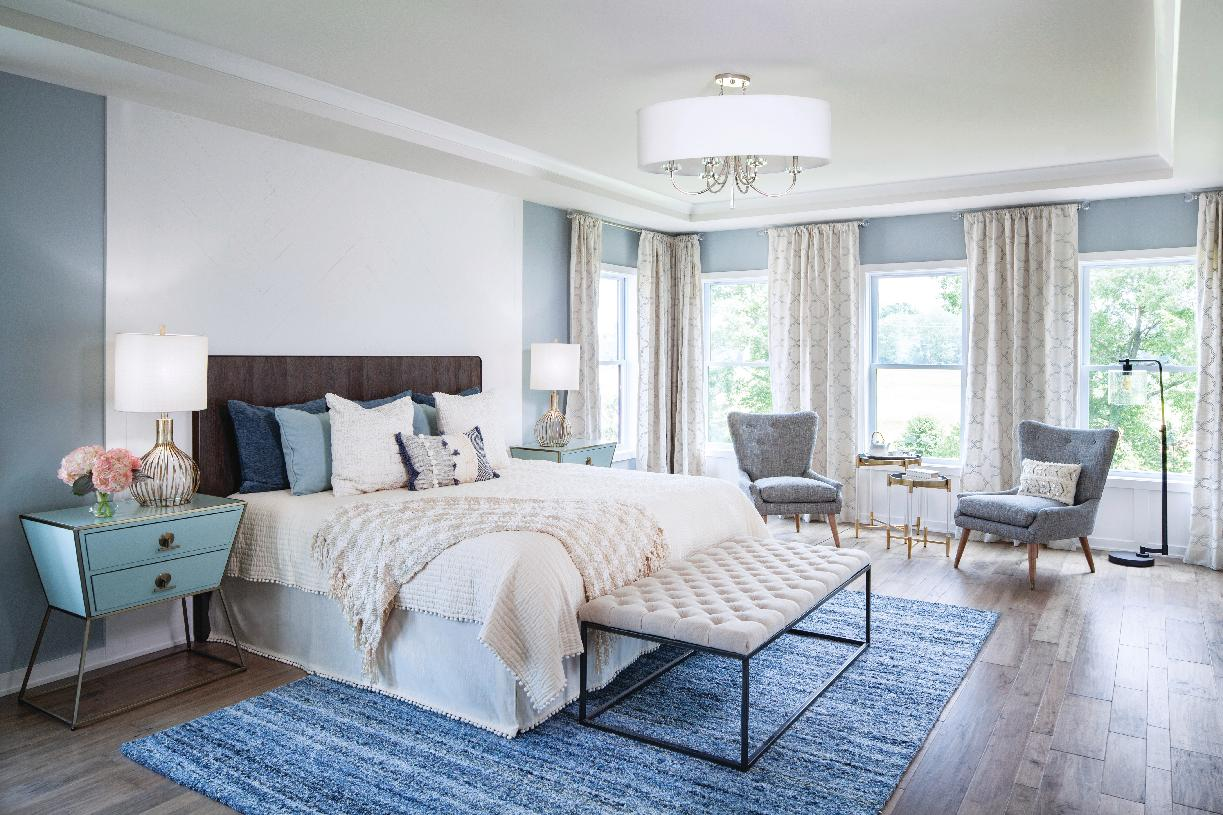 Relax in the spacious primary bedroom suite