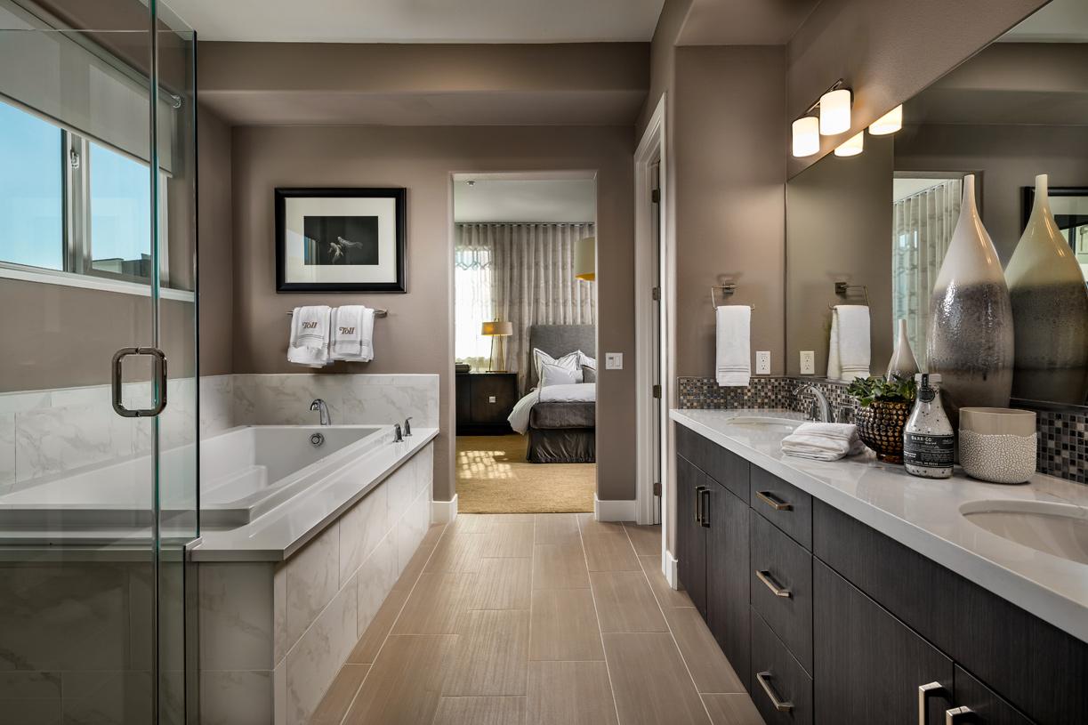 Dual sink vanities and sinking tub in primary bath oasis