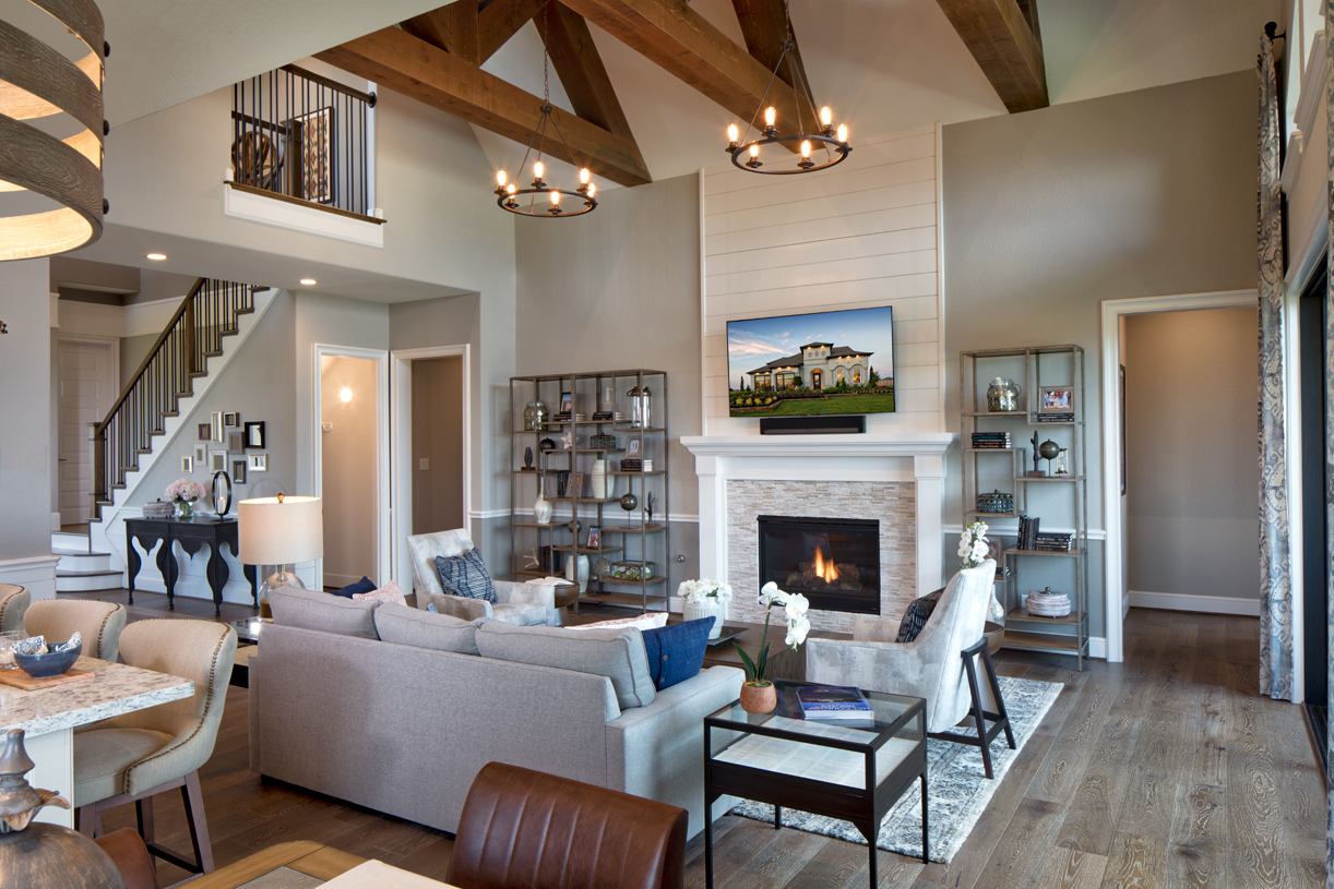 Open Juniper great room with center fireplace