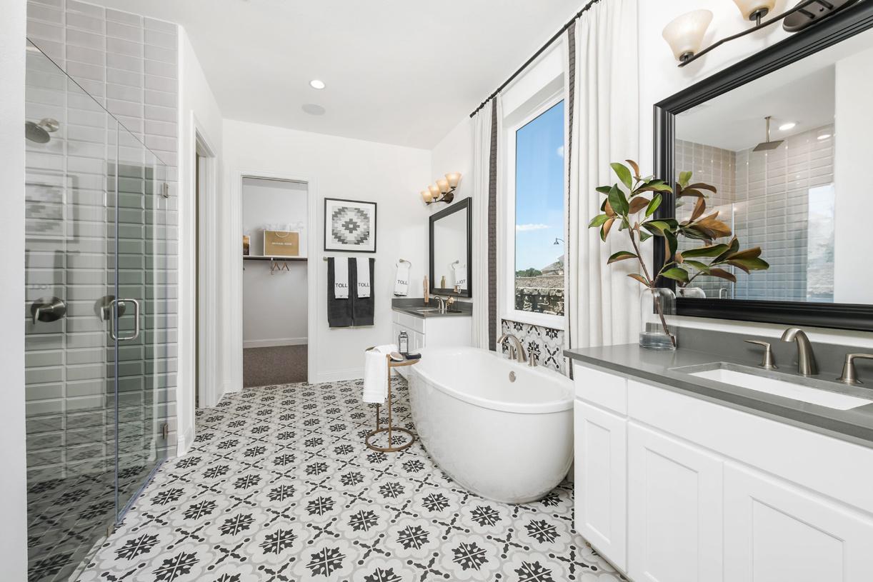 Spa-like Longview primary bath with freestanding tub