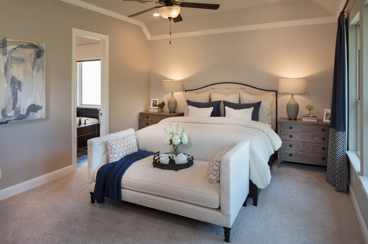 The spacious Draper primary bedroom suite features dual walk-in closets