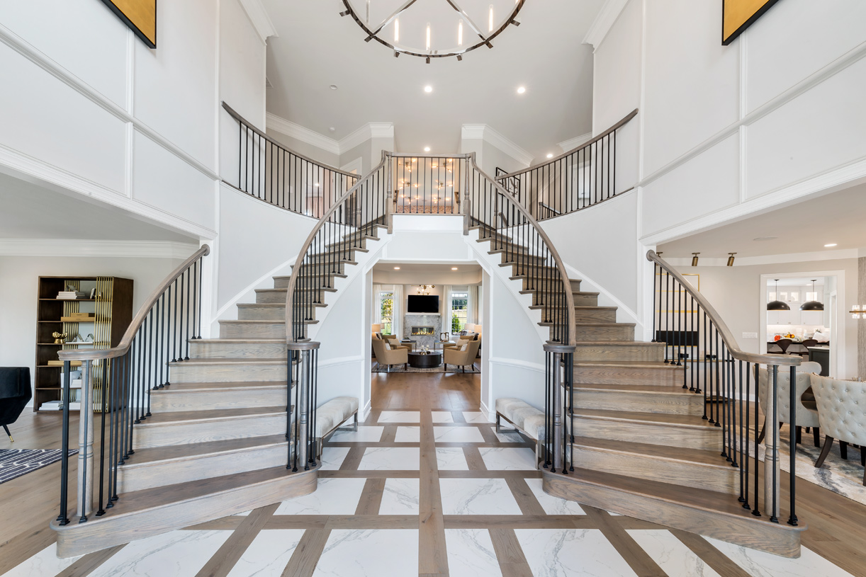 Stunning entryway with dual staircase