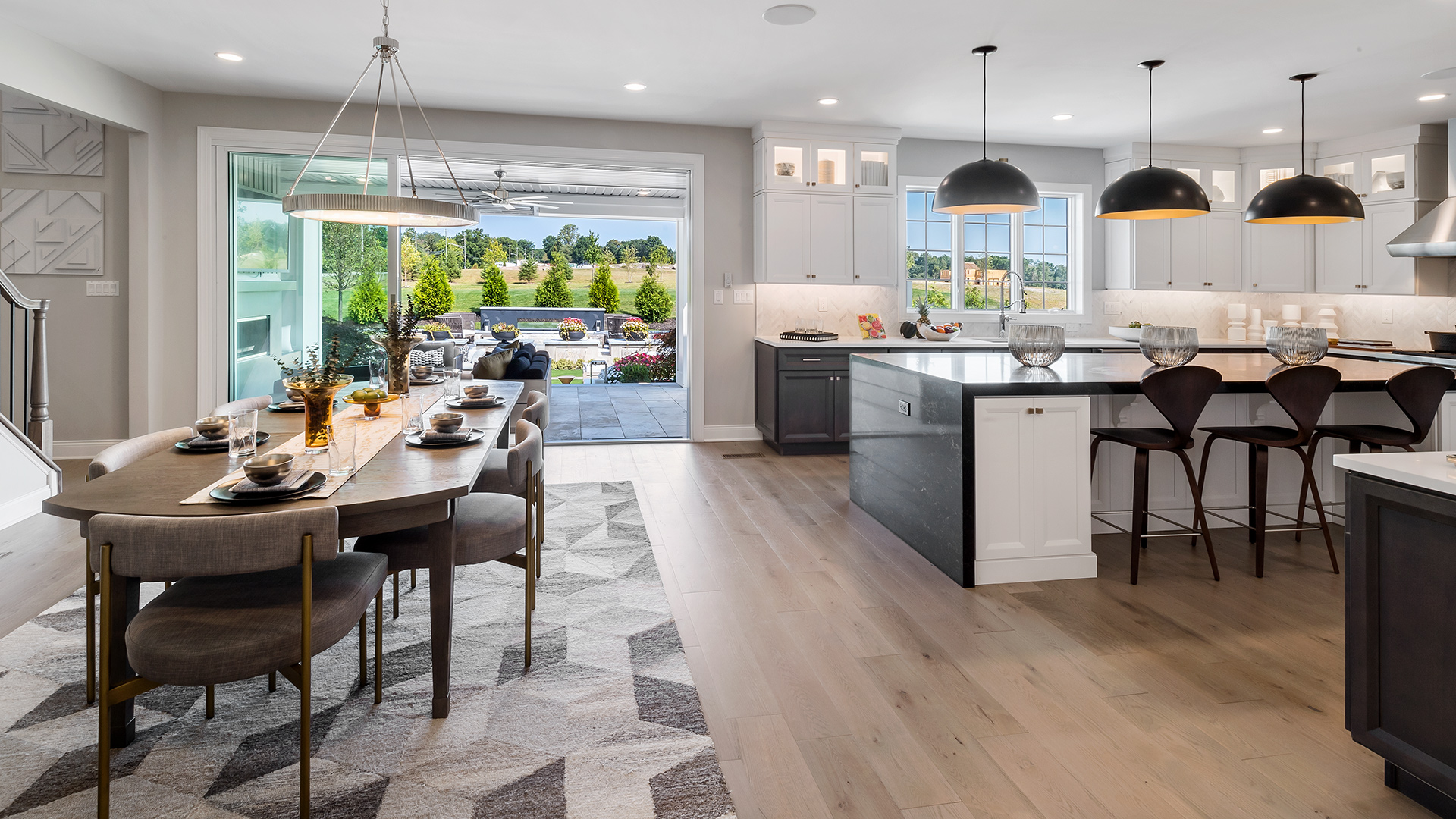 Kitchen and dining area overlooking the welcoming outdoor living space