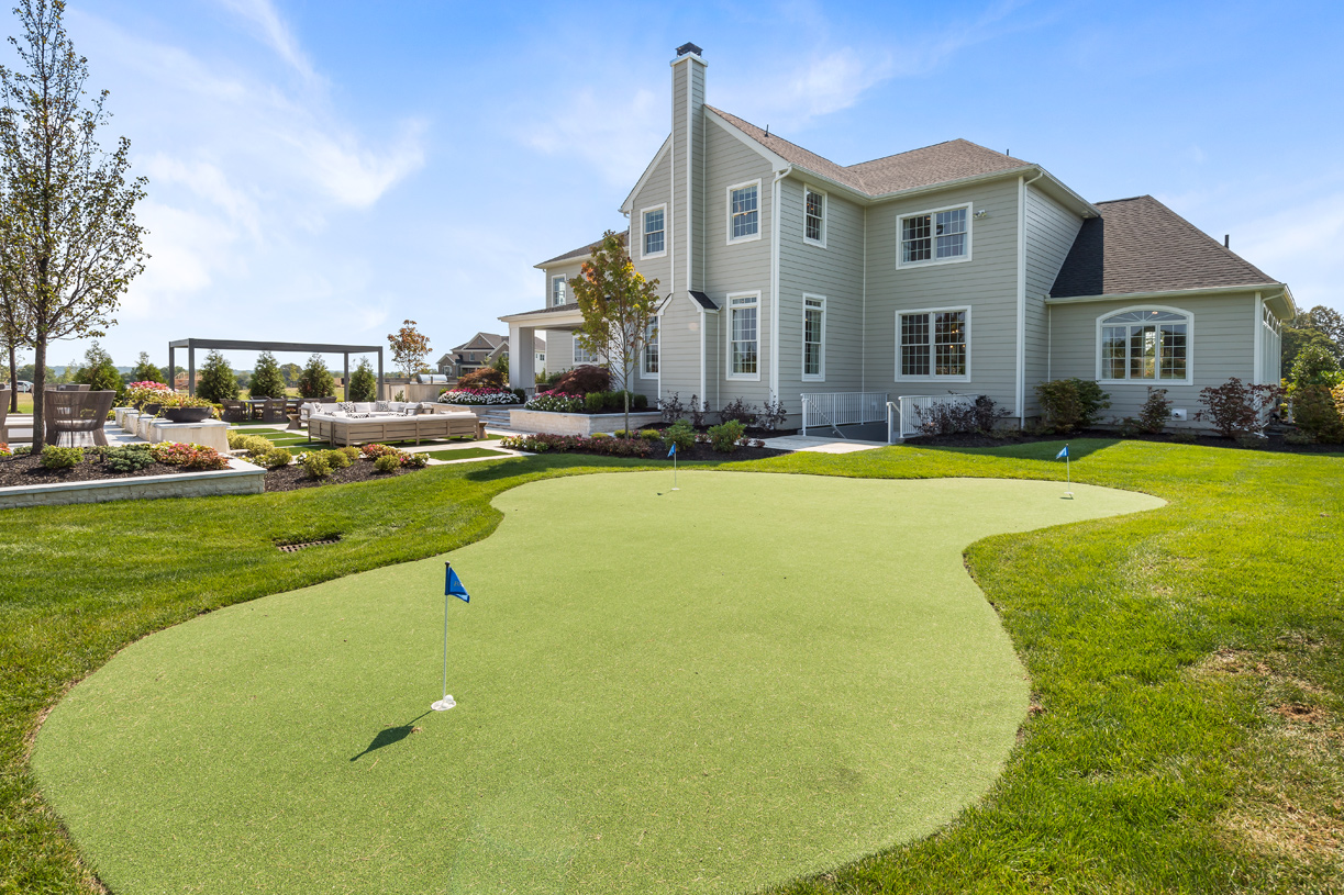 Personal outdoor putting green to work on your golf game