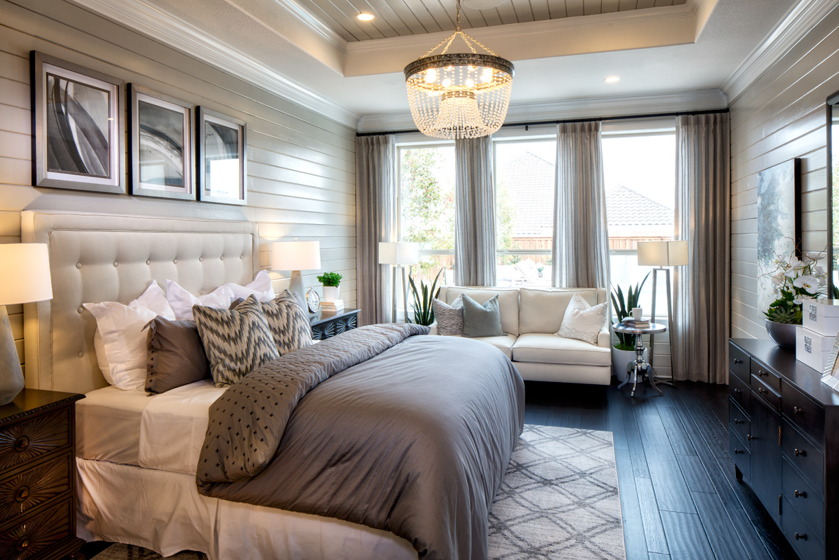 Newcastle's fantastic primary bedroom suite is enhanced by a tray ceiling