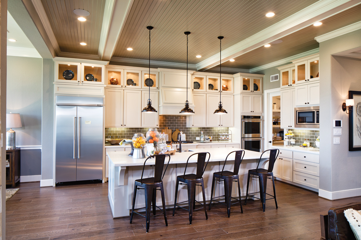 Open-concept floor plan of the Newcastle boasts an elevated ceiling that unifies the great room and kitchen