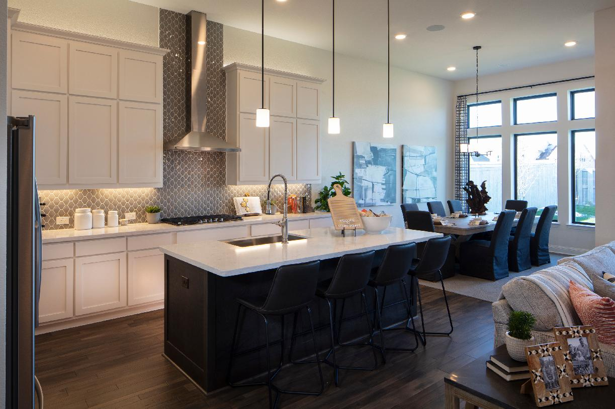 Well-equipped kitchen overlooks the bright dining room