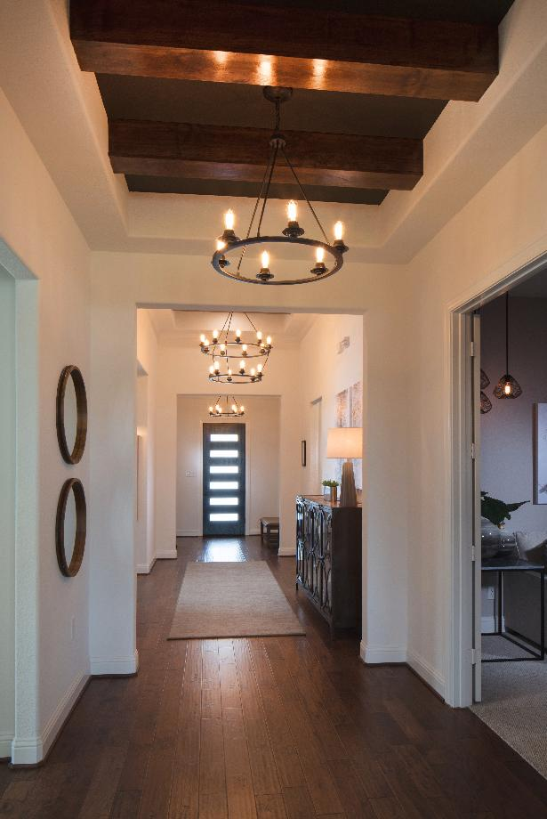 Lovely elongated foyer with tray ceiling