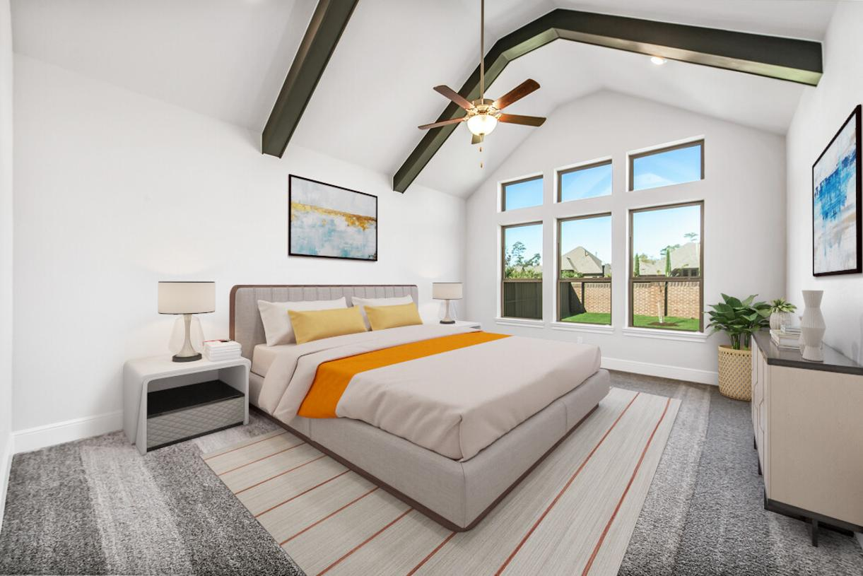 Gorgeous primary bedroom suite is complete with a beautiful vaulted ceiling