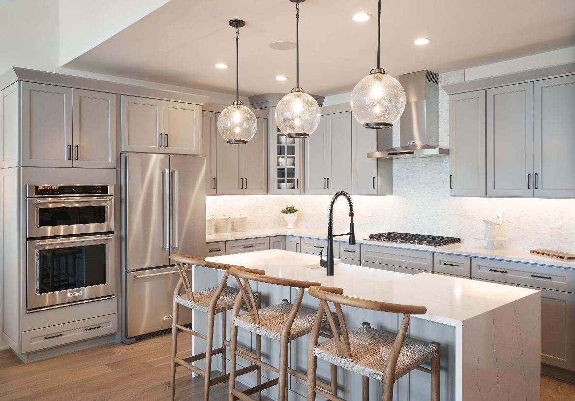 Well-designed kitchen with breakfast bar and ample counter space