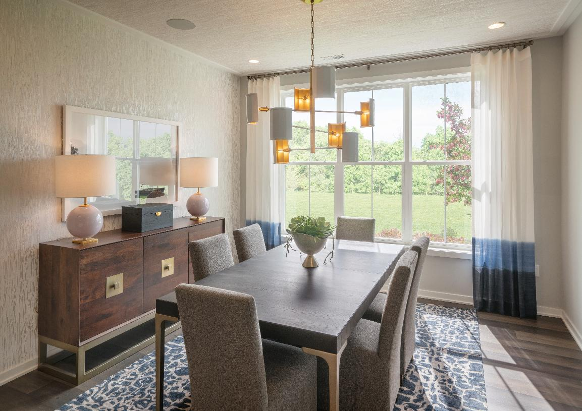 Foyer opens to beautiful formal dining room