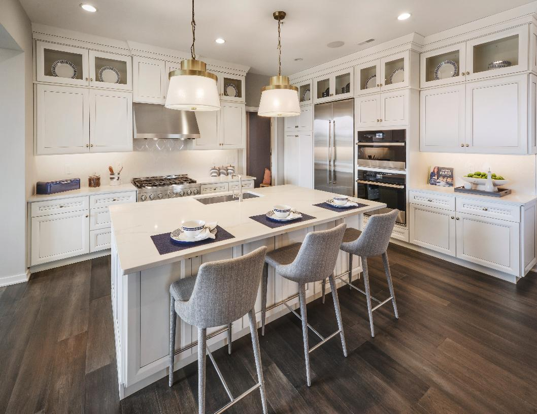 Well-designed kitchen features center island, pantry and ample counter space