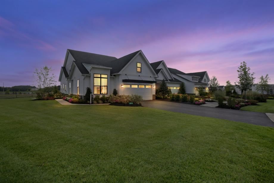 Professionally decorated model home with numerous designer upgrades