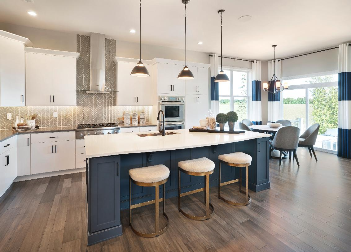 Upgraded kitchen with center island and casual dining area