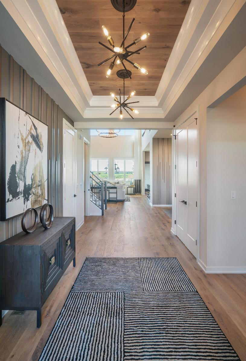 Inviting foyer leads to formal diving room and two-story great room