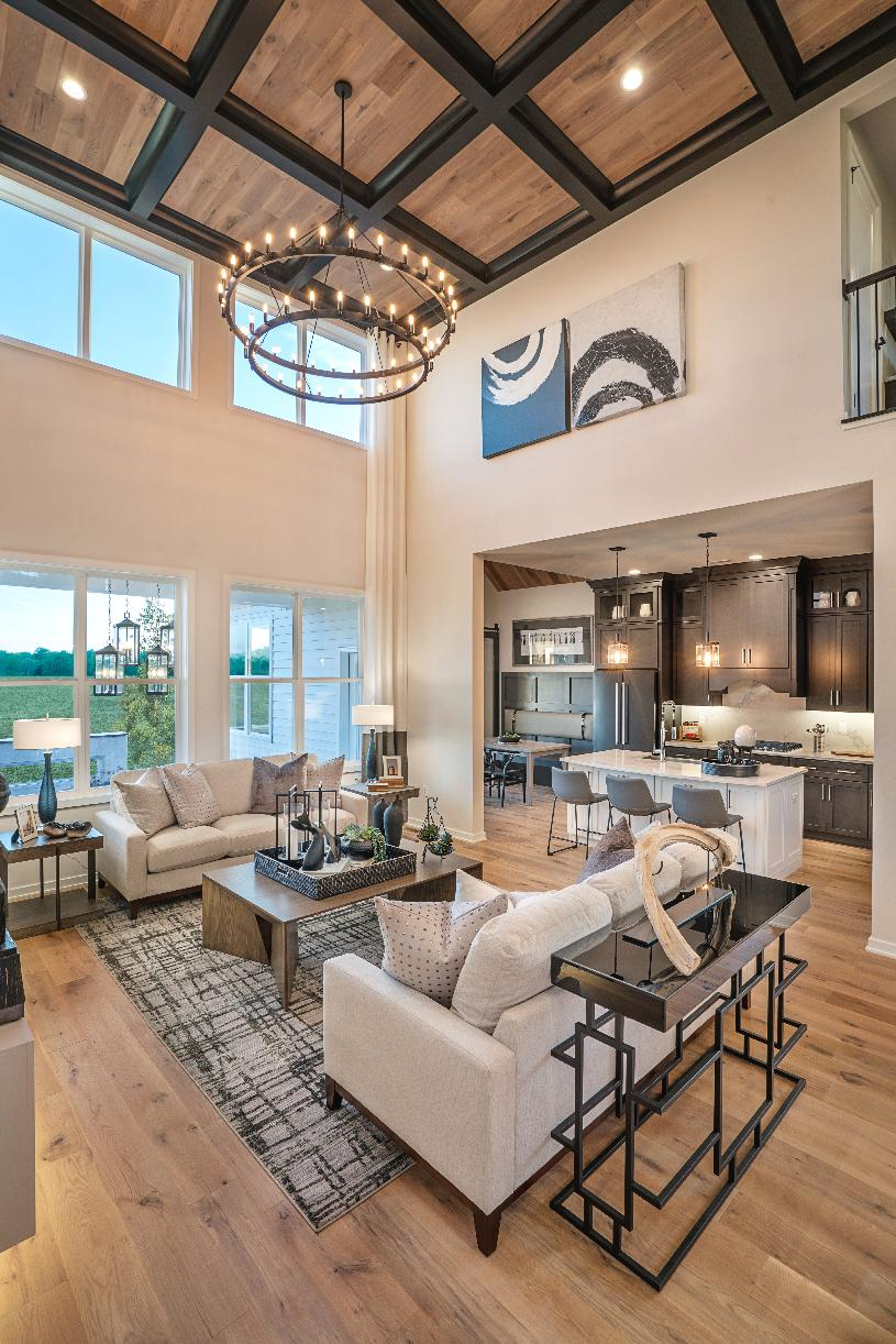 Open-concept kitchen, casual dining area, and living room
