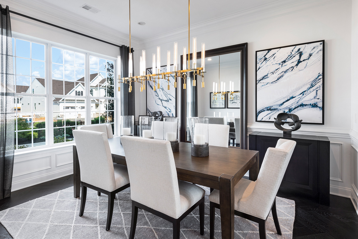 An upgraded lighting fixture in the dining room creates a pretty centerpiece for the room
