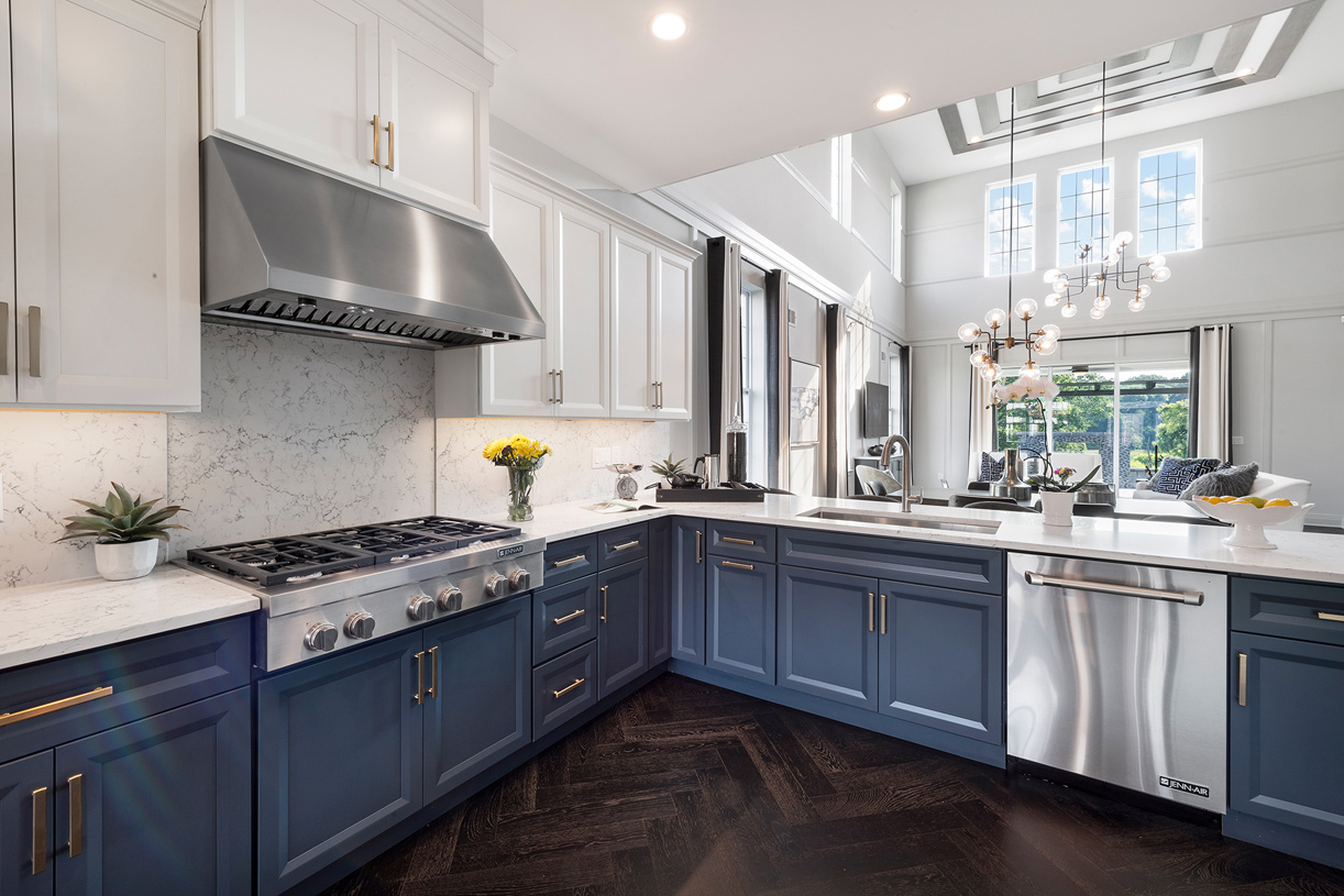 Premium finishes in the kitchen include name-brand appliances, upgraded cabinets, and hardwood floors