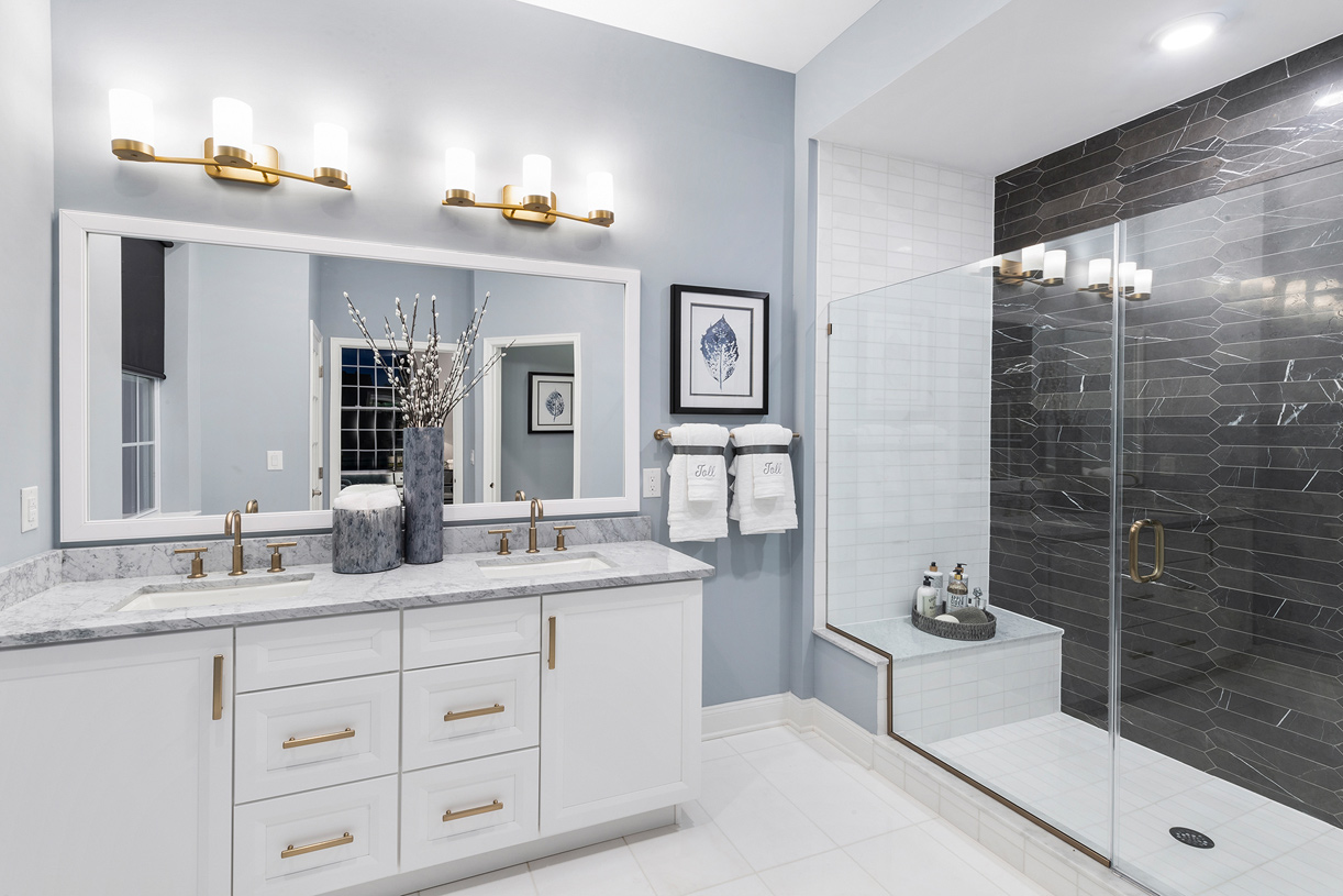 The appealing primary bedroom suite boasts a lavish bath