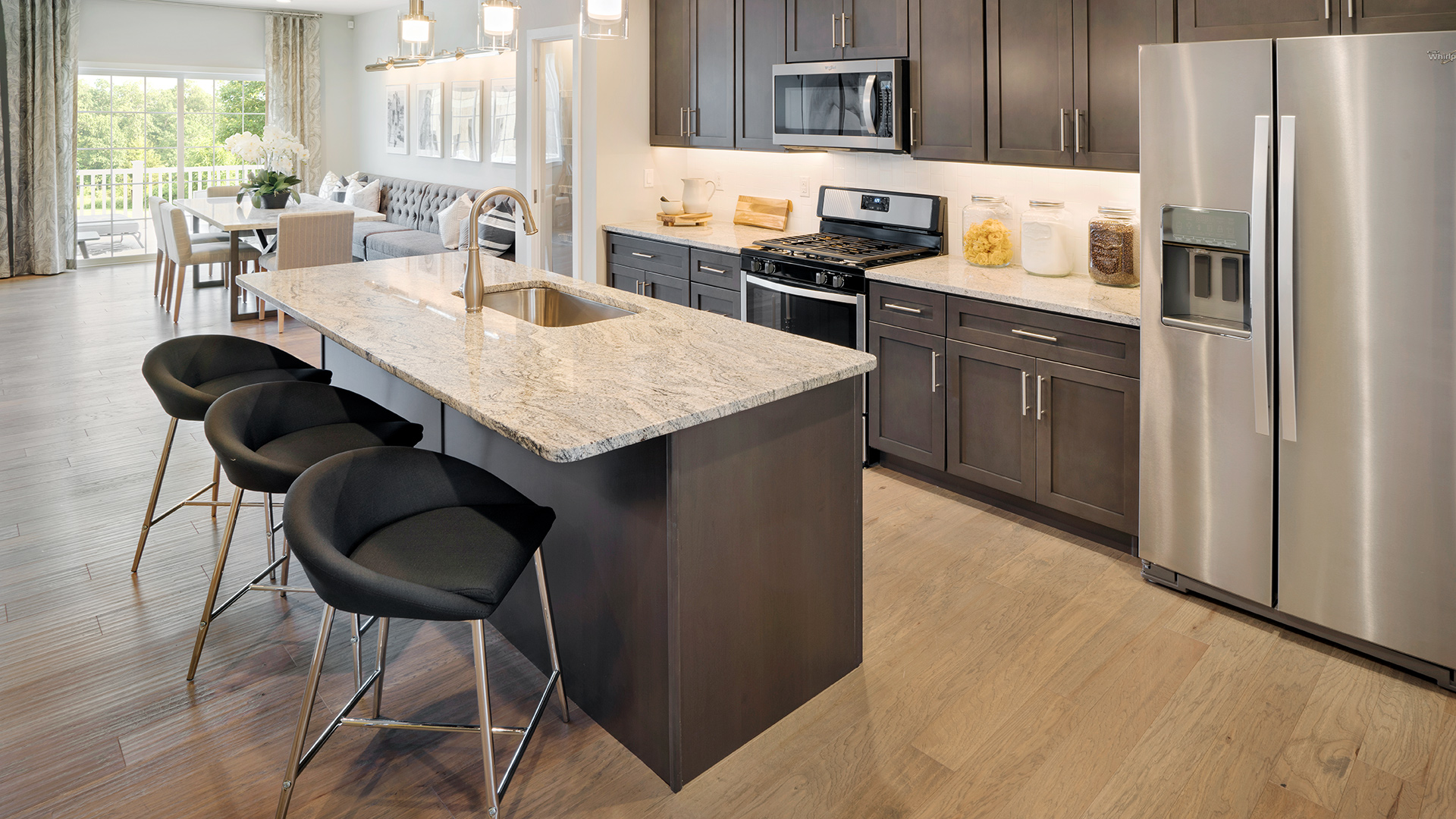 The Brookville kitchen with beautiful center island with breakfast bar