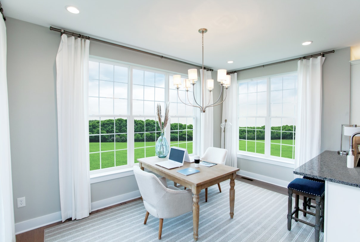 Morning room located off the kitchen provides a great work space