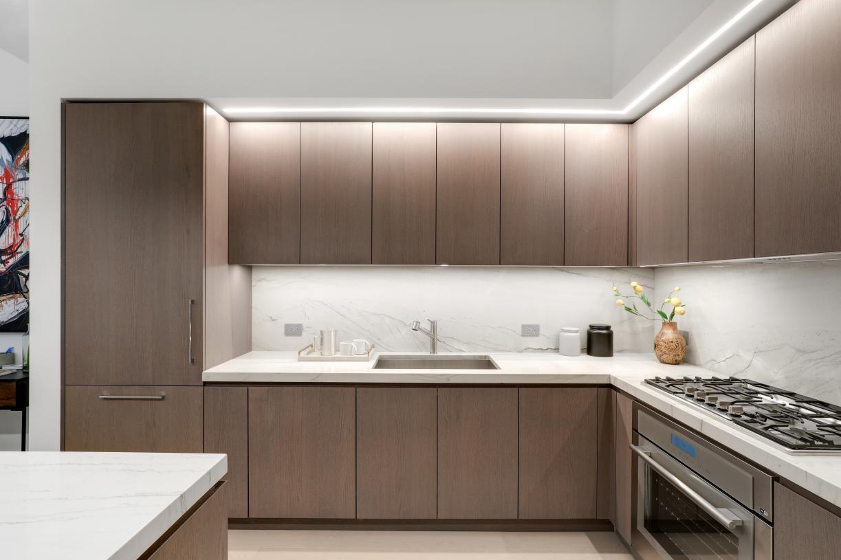 Kitchens with Copa Do Brazil quartzite countertops and backsplash, and custom Italian oak cabinetry by Scavolini