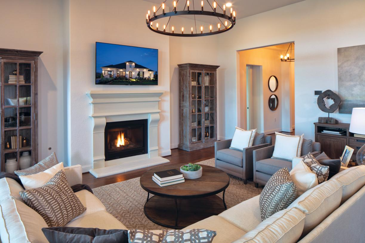 Great room with fireplace and upgraded lighting