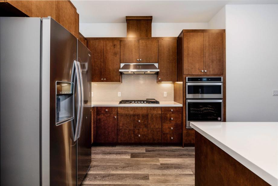 Toll Brothers Chancery Lane Penthouse Gourmet Kitchen with Upgraded Countertops and Tile Backsplash