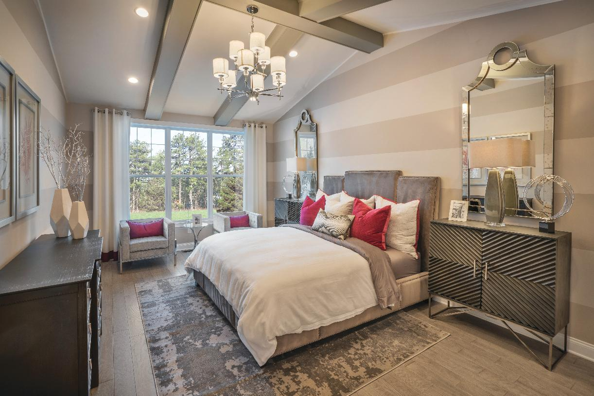 First-floor primary bedroom suite with vaulted ceiling